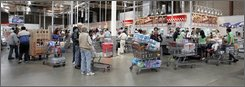 In this May 28, 2008 file photo, shoppers wait in line to check out at Costco in Mountain View, Calif.. Most inflation this year has come from food and fuel, as retailers resisted passing along to strapped consumers the higher prices manufacturers charged them. Coming price increases from companies such as Johnson & Johnson and Hasbro Inc. may leave them with no choice.  (AP Photo/Paul Sakuma, file)
