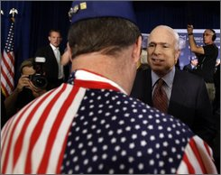 Republican presidential candidate Sen. John McCain, R-Ariz. greets audience members as he makes a campaign stop at the American GI Forum Convention in Denver, Friday, July 25, 2008. (AP Photo/Carolyn Kaster)