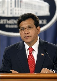 In this Aug. 27, 2007 file photo, Attorney General Alberto Gonzales announces his resignation during at a news conference at the Justice Department in Washington. A new Justice Department report concludes that politics illegally influenced the hiring of career prosecutors and immigration judges, and largely lays the blame on top aides to former Attorney General Alberto Gonzales.  (AP Photo/Pablo Martinez Monsivais, File)