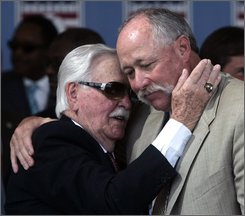 "Dick Williams, left, and Rich ""Goose"" Gossage hug after being inducted into the Baseball Hall of Fame in Cooperstown, N.Y., Sunday, July 27, 2008. (AP Photo/Mike Groll)"