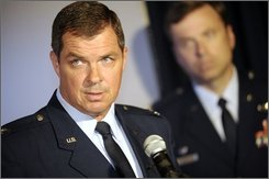 Commander of the 3rd Wing, Col. Richard Walberg discusses the death of former wing commander Brig. Gen. Thomas L. Tinsley during a press conference held Monday July 28, 2008 on Elmendorf Air Force Base in Anchorage, Alaska. Lt. Col. Michael Paoli, an Air Force spokesman, said the death is under investigation, and there doesn't appear to be any indication of foul play at this time. Col. Mark Chance of the 3rd Wing stands beside Walberg.  (AP Photo/Matt Hage)