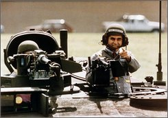 This Sept. 13, 1988 file photo shows Democratic Presidential candidate Michael Dukakis as he gets a free ride in one of General Dynamics' new M1-A-1 battle tanks at its land systems division in Sterling Heights, Mich.     (AP Photo/Michael E. Samojeden, FILE)