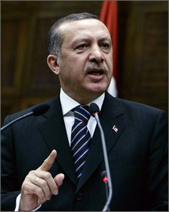 Turkish Prime Minister Tayyip Erdogan addresses the lawmakers of his ruling Justice and Development Party at the parliament in Ankara, Turkey, Tuesday, July 29, 2008. Erdogan said Tuesday that Turks should unite in the face of terrorism, two days after bombings that killed 17 people in a mostly residential neighborhood of Istanbul.(AP Photo/Burhan Ozbilici)
