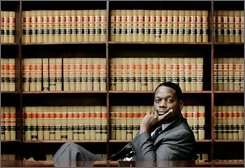 Dallas County District Attorney Craig Watkins poses in his Dallas law office, Dec. 21, 2006. During his 36-years in office, former Dallas County District Attorney Henry Wade convicted more than 90 percent of the defendants in his purview.  Nineteen convictions -- so far -- won by Wade and his successors are being overturned, some two-thirds of them involving black men. An estimated 250 cases remain for review. Watkins, says more will go free. (AP Photo/Tony Gutierrez, File)
