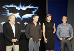 "From left, producer Charles Roven, actor Christian Bale, actress Maggie Gyllenhaal and actor Aaron Eckhart, smile during a press conference to promote their new Batman movie ""The Dark Knight"" in Tokyo, Japan, Tuesday, July 29, 2008. (AP Photo/Koji Sasahara)"