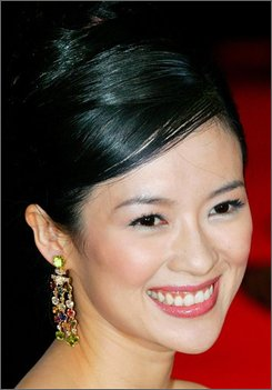 "In this Nov. 29, 2005 file photo, Chinese actress Zhang Ziyi smiles as she arrives for the world premiere of her movie ""Sayuri"" in Tokyo. ""Crouching Tiger, Hidden  Dragon"" star Zhang Ziyi is puzzled by the protests against China's human rights record before the Beijing Olympics, a magazine reports. (AP Photo/Itsuo Inouye, FILE)"