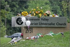 Flowers and balloon's lay on the church sign serving as a memorial at the Tennessee Valley Unitarian Universalist Church  Monday, July 28, 2008 in Knoxville, Tenn. A gunman opened fire at a church youth performance Sunday, killing two people. (AP Photo/Wade Payne)