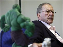 Sen. Ted Stevens, R-Alaska, sits next to an Incredible Hulk figure as he answers question in Anchorage, Alaska on Wednesday, May 28, 2008. The longest-serving Republican senator and a figure in Alaska politics since before statehood, was indicted Tuesday, July 29, 2008, on seven counts of failing to disclose thousands of dollars in services he received from a company that helped renovate his home. (AP Photo/Al Grillo)