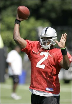 In this July 24, 2008, file photo, Oakland Raiders quarterback JaMarcus Russell passes the ball during workouts at their football training camp in Napa, Calif., Thursday.  Russell was held out of team drills for the second straight practice Wednesday, July 30, 2008, because is throwing elbow was still sore after banging off the helmet of teammate Darren McFadden. (AP Photo/Eric Risberg,file)