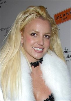 "In this Dec. 1, 2007 file photo, singer Britney Spears poses on the press line at the Scandinavian Style Mansion party in Los Angeles. An attorney for Spears said Wednesday, July 30, 2008 that he will not seek an extension for a restraining order against Osama ""Sam"" Lutfi, but that doesn't mean the pop star wants her former sidekick back in her life. (AP Photo/Dan Steinberg, File)"