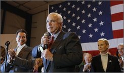 In this Feb. 5, 2008, file photo Republican presidential hopeful, Sen. John McCain, R-Ariz., center, campaigns with California Gov. Arnold Schwarzenegger at a rally in San Diego, Calif., on Super Tuesday, the day of the presidential primary elections.  But Schwarzenegger, who endorsed McCain and will appear on his behalf at the Republican National Convention this summer, commonly answers questions about global warming and other topics by saying that either candidate, McCain or rival Democratic candidate Barack Obama, will be a big improvement over President Bush.  (AP Photo/Charles Dharapak, File)