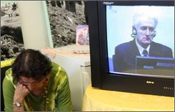 Bosnian Muslim woman, Kada Hotic, a survivor of the genocide operations in Srebrenica in 1995, cries as she watches a live broadcast of the Hague Tribunal?s indictment reading for Radovan Karadzic, in Sarajevo, on Thursday, July 31 , 2008. Karadzic, considered to be the mastermind of Bosnian Serb campaign of ethnic cleansing in Bosnia 1992-95, made his first appearance before the War crimes Tribunal in the Hague. Karadzic was arrested in Belgrade last week after 13 years of hiding. (AP Photo/Hidajet Delic)