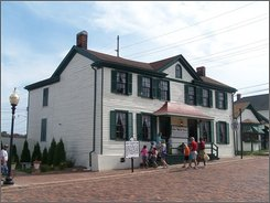 In this undated photo provided by the Mark Twain Boyhood Home & Museum, the Becky Thatcher House is seen in Hannibal , Mo. Even though downtown Hannibal has remained bone dry, enough visitors shied away from the Mississippi River town due to flooding concerns that summer attendance at Clemens' boyhood home is down about 30 percent. That has hampered efforts to raise money to restore the little wood-frame house Twain enthusiasts desperately want to protect. (AP Photo/Mark Twain Boyhood Home & Museum)