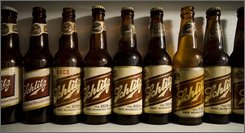 A variety of antique Schlitz beer bottle are seen from the Leonard Jurgensen collection Wednesday, July 23, 2008, in Oconomowoc, Wis. That beer with the old-time mystique is back on shelves in bottles of its original formula in the city where it was first brewed more than a century and a half ago.  (AP Photo/Morry Gash)