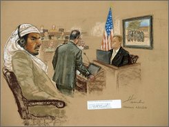 In this file photograph of a sketch by courtroom artist Janet Hamlin, reviewed  by the U.S. Military, defendant Salim Hamdan watches as FBI agent Craig Donnachie testifies about his interrogations of Hamdan, while a picture of disguised U.S. agents is displayed on a screen, during Hamdan's trial inside the war crimes courthouse at Camp Justice, the legal complex of the U.S. Military Commissions, at Guantanamo Bay U.S. Naval Base, in Cuba, Thursday, July 24, 2008. Hamdan, the former driver for Osama bin Laden, is the first prisoner to face a U.S. war-crimes trial since World War II. (AP Photo/Janet Hamlin, Pool, File)