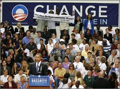 Democratic presidential candidate Sen. Barack Obama, D-Ill. has his speech interrupted by protesters, Friday, Aug. 1, 2008, during a town hall meeting in St. Petersburg, Fla. (AP Photo/Mike Carlson)