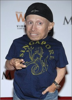 Actor Vern Troyer poses on the press line at the Maxim X-Games Party in Los Angeles Thursday, July 31, 2008. The battle over a sex tape featuring Troyer has reignited after the actor filed suit Thursday against his ex-girlfriend for $20 million, claiming she allowed snippets of the tape to be released. Troyer's lawsuit also claims that his ex-girlfriend, Ranae Shrider, was abusive and inflicted emotional distress on him. (AP Photo/Dan Steinberg)