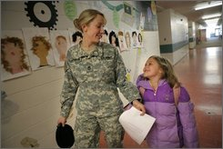 Sgt. 1st Class Janelle Johnson, left, and her daughter, Elizabeth, chat as they walk along the hallway at Dr. Knight Elementary School in Randall, Minn., Thursday, April 3, 2008.  Johnson served in Iraq for 16 months. Her daughters, Emily and Elizabeth, were 6 months and 4 years old, respectively, when she was deployed. (AP Photo/Jae C. Hong)