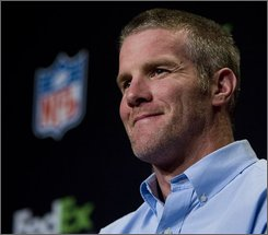 In this Jan. 30, 2008 file photo, Green Bay Packers' Brett Favre smiles at the FedEx Air & Ground NFL Players of the Year news conference in Phoenix. The NFL announced Sunday, Aug. 3, 2008 that Favre will be reinstated and added to the Packers' active roster on Monday. (AP Photo/Charlie Riedel, File)