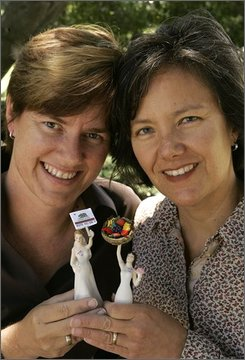 Pamela Brown, left, and her wife Shauna are seen with the cake-toppers from their wedding cake, Monday, Aug. 4, 2008, in Berkeley, Calif.  Brown, 40, and Shauna Brown, 42, are one of many same-sex couples whose nuptials are made possible by California Supreme Court's May 15 ruling that legalized gay marriage. (AP Photo/Ben Margot)