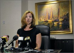 Julie Gochar, managing partner of Obsidian Reality, speaks to reporters Monday, Aug. 4, 2008 in Baltimore about her firm's role in helping authorities find a man known as Clark Rockefeller, who allegedly abducted his 7-year-old daughter Reigh Boss. Rockefeller was arrested Aug. 2 in Baltimore. (AP Photo/ Steve Ruark)