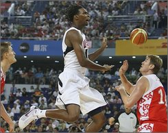 Chris Bosh of USA men's basketball team for the Beijing 2008 Olympics reacts after missing to score during a match between USA and Russia as a warm-up for Olympics at the USA Basketball International Challenge tournament in Shanghai Sunday Aug. 3, 2008. US won 89-68. (AP Photo/Eugene Hoshiko)