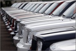In this June 22, 2008 file photo, unsold 2008 Liberty sports-utility vehicles sit at a Chrysler-Jeep dealership in the southeast Denver suburb of Centennial, Colo.  A shakeout in the auto leasing industry that revved up with Chrysler's exit from the leasing business last week is expected to be felt quickly by consumers who enjoy switching vehicles every two or three years without down payments or other ownership obligations. (AP Photo/David Zalubowski)