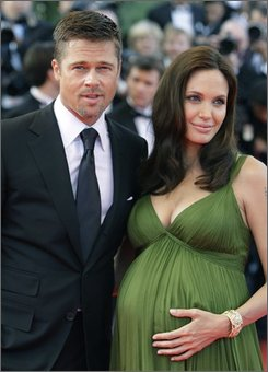 "In this May 15, 2008 file photo, American actors Brad Pitt and Angelina Jolie arrive for the premiere of the film ""Kung Fu Panda,"" during the 61st International film festival in Cannes, southern France. People magazine has scored the U.S. rights to exclusive photos of Brad Pitt and Angelina Jolie's newborn twins, a representative for the magazine told The Associated Press on Friday. (AP Photo/Matt Sayles, file)"