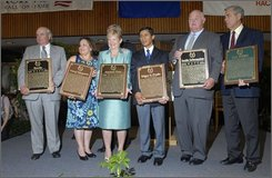 Participants in the 2008 National Museum of Racing and Hall of Fame induction ceremony in Saratoga Springs, N.Y. hold their plaques Monday, Aug. 4, 2008.  From left are