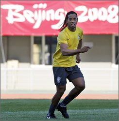  Brazilian soccer player Ronaldinho works out during a training session for the Brazil Men's soccer team for the Beijing 2008 Olympics soccer matches held in Shenyang, northeastern China's Liaoning province, Sunday, Aug. 3, 2008. (AP Photo/Ng Han Guan)