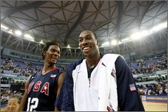 Chris Bosh, left and Dwight Howard, right,  of USA men's basketball team for the Beijing 2008 Olympics smile after a match between USA and Australia as a warm-up for Olympics at the USA Basketball International Challenge tournament in Shanghai Tuesday Aug. 5, 2008. US won 87-76. (AP Photo/Eugene Hoshiko)