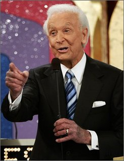 "In this June 6, 2007 file photo, game show host Bob Barker, 83, gestures during the taping of his final episode of ""The Price Is Right"" in Los Angeles. (AP Photo/Damian Dovarganes, file)"