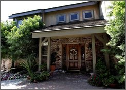 """A house is photographed at 1920 Lorain Road in San Marino, Calif., Wednesday, Aug. 6, 2008. The previous owners of the property, Jonathan and Linda Sohus, vanished without a trace in 1985. A man known as Clark Rockefeller accused of kidnapping his 7-year-old daughter during a visit in Boston, is a """"person of interest"""" in the case of Jonathan and Linda Sohus. After his arrest in Baltimore, police realized Rockefeller's fingerprints matched those on an old license application submitted by Christopher Chichester -- a man who lived in a guesthouse on the Sohus' property and was a target of the initial investigation. (AP Photo/Nick Ut)"""