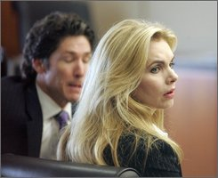 Victoria Osteen and her husband Joel Osteen, left, sit in court during a break in testimony in her civil trial Thursday, Aug. 7, 2008  in Houston.  Victoria, the co-pastor of Lakewood Church, is being sued by Continental flight attendant Sharon Brown who says Osteen assaulted her on a plane. (AP Photo/Pat Sullivan)