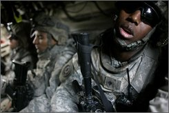 U.S. army soldiers attached to Palehorse Troop, 2nd Squadron, 2nd Stryker Cavalry Regiment, take a nap in the back of a Stryker armored vehicle in the village of Baaya, about 40 kilometers (25 miles) north of Baghdad, in Iraq's Diyala province, Thursday, Aug. 7, 2008. Two Iraqi officials say the U.S. and Iraq are close to a deal under which all American combat troops would leave by October 2010 with remaining U.S. forces gone about three years later. (AP Photo/Marko Drobnjakovic)