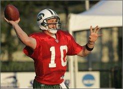 New York Jets quarterback Chad Pennington throws a football during training camp in Hempstead, N.Y., Thursday, July 24, 2008. (AP Photo/Ed Betz)