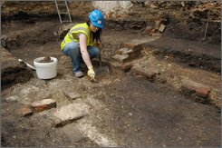 In this undated photo made available in by the Museum of London, in London, Wednesday Aug. 6, 2008, an archeologist works on uncovering the remains of one of London's earliest theatres where a young William Shakespeare is thought to have trod the boards. The find, believed to be a section of one of London's earliest playhouses, was unearthed as the site was being prepared for the construction of a new theatre. Experts have thought for many years that an open air playhouse, called The Theatre, stood in the Shoreditch area of London but its exact location had remained uncertain. A young William Shakespeare trod the boards at the theatre, which opened in 1576, as part of The Lord Chamberlain's Men company of players.(AP Photo/Museum of London, ho)
