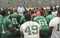 "Republican presidential candidate Sen. John McCain, R-Ariz.,  center, gives the Marshall University football team a pep tall during practice, on  Aug. 6, 2008 in Huntington, W.Va.  McCain told the players he'd learned the value of teamwork during his incarceration as a POW in Vietnam. ""When we didn't work as a team they broke us down...we were a team and we had leaders,"" he said. (AP Photo/Mary Altaffer)"