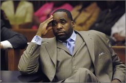 Detroit Mayor Kwame Kilpatrick sits in court during an emergency bond appeal hearing in front of Judge Thomas Jackson at the Wayne County Third Circuit Court, Friday, August 8, 2008 in Detroit. Judge Jackson ruled that Kilpatrick could go free after spending Thursday night in jail but must post a $50,000 cash bond. After the judge ruled he violated terms of his release on bond, he  is barred from any travel outside the state, and must wear an electronic tether.(AP Photo/Bryan Mitchell)