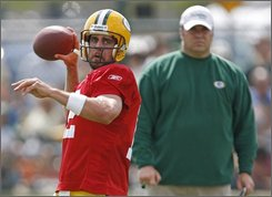 Green Bay Packers quarterback Aaron Rodgers, left, looks to make a pass as head coach Mike McCarthy looks on during football training camp, Tuesday, Aug. 5, 2008, at Clarke Hinkle Field in Green Bay, Wis.  (AP Photo/Matt Ludtke)