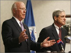 Sen. Patrick Leahy, D-Vt., left, speaks during a news conference with FBI Director Robert Mueller in Williston, Vt., Thursday, Aug. 7, 2008. Leahy spoke Thursday about being targeted by one of a series of anthrax-laced letters sent by an Army bioweapons scientist who committed suicide last week. (AP Photo/Toby Talbot)