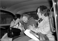 This  Feb. 13, 1978 file photo shows Joyce McKinney, center, a former beauty queen from North Carolina, in the back of a London taxi with her mother and an unidentified man after being granted permission by a judge to vary the terms of bail in connection with her forthcoming kidnap trial. (AP Photo, File)