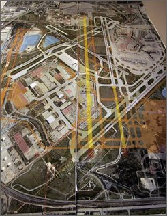 A map showing the north area of construction at O'Hare International Airport is seen in this Wednesday, Jan. 4, 2006 file photo, at the airport in Chicago. Soaring gas prices have claimed plenty of victims -- from SUV sales to cross-country vacations in the family car. They now threaten to claim another