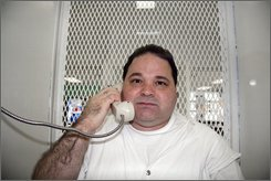 """Texas death row inmate Michael Rodriguez listens during a death row interview at the Polunsky Unit of the Texas Department of Criminal Justice in Livingston, Texas, July 30, 2008. Rodriguez, a participant in one of Texas' most notorious prison breaks, is set to become the first of the six surviving members of the infamous """"Texas 7"""" -- all of them now on death row -- to go to the death chamber. (AP Photo/Mike Graczyk)"""