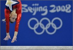 U.S. gymnast Alicia Sacramone performs on the balance beam during the women's qualification rounds at the Beijing 2008 Olympics in Beijing, Sunday, Aug. 10, 2008.  (AP Photo/Amy Sancetta)