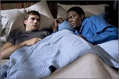 "In this undated photo originally provided by Columbia Pictures, Ashton Kutcher, left, and Bernie Mac are shown in a scene from "" Guess Who."" Mac, an award-winning actor-comedian died at age 50 from complications of pneumonia, his publicist said Saturday, Aug. 9, 2008. (  (AP Photo/Columbia Pictures, Claudette Barius)"
