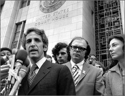 "In this Jan. 17, 1973 file picture, co-defendant Anthony Russo, right, listens as Daniel Ellsberg gives a news conference outside the Federal Building in Los Angeles saying the Pentagon Papers trial prosecutors were acting out ""their contempt for the American people"" by placing a movie screen between the trial principals and the press and public, seated at the back of the courtroom. The judge ordered the screen removed and replaced by a smaller one along the wall. Russo, a researcher who helped leak the Vietnam-era Pentagon Papers to the media and prompted wider public questioning of the war, died Wednesday, Aug. 6, 2008. He was 71. The case that became known as the Pentagon Papers helped put the Vietnam War on trial. (AP Photo)"