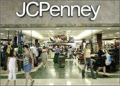 In this Aug. 13, 2005 file photo, customers walk out of a J.C. Penny department store, in Dallas. J.C. Penney Co. Inc. Amid the piles of retailers' downbeat July, 2008 sales reports, there was one sliver of hope