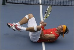 Rafael Nadal of Spain returns to Potito Starace of Italy during first round tennis at the Beijing 2008 Olympics in Beijing, Monday, Aug. 11, 2008. (AP Photo/Elise Amendola)