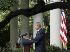 President Bush makes remarks about the situation in Georgia in the Rose Garden of the White House, Monday, Aug. 11, 2008, in Washington. Bush said that Russia must reverse course in Georgia and withdraw its troops. (AP Photo/Lawrence Jackson)